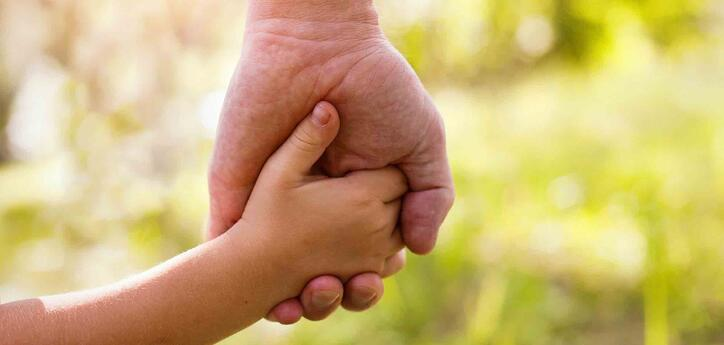 father-and-son-holding-hands